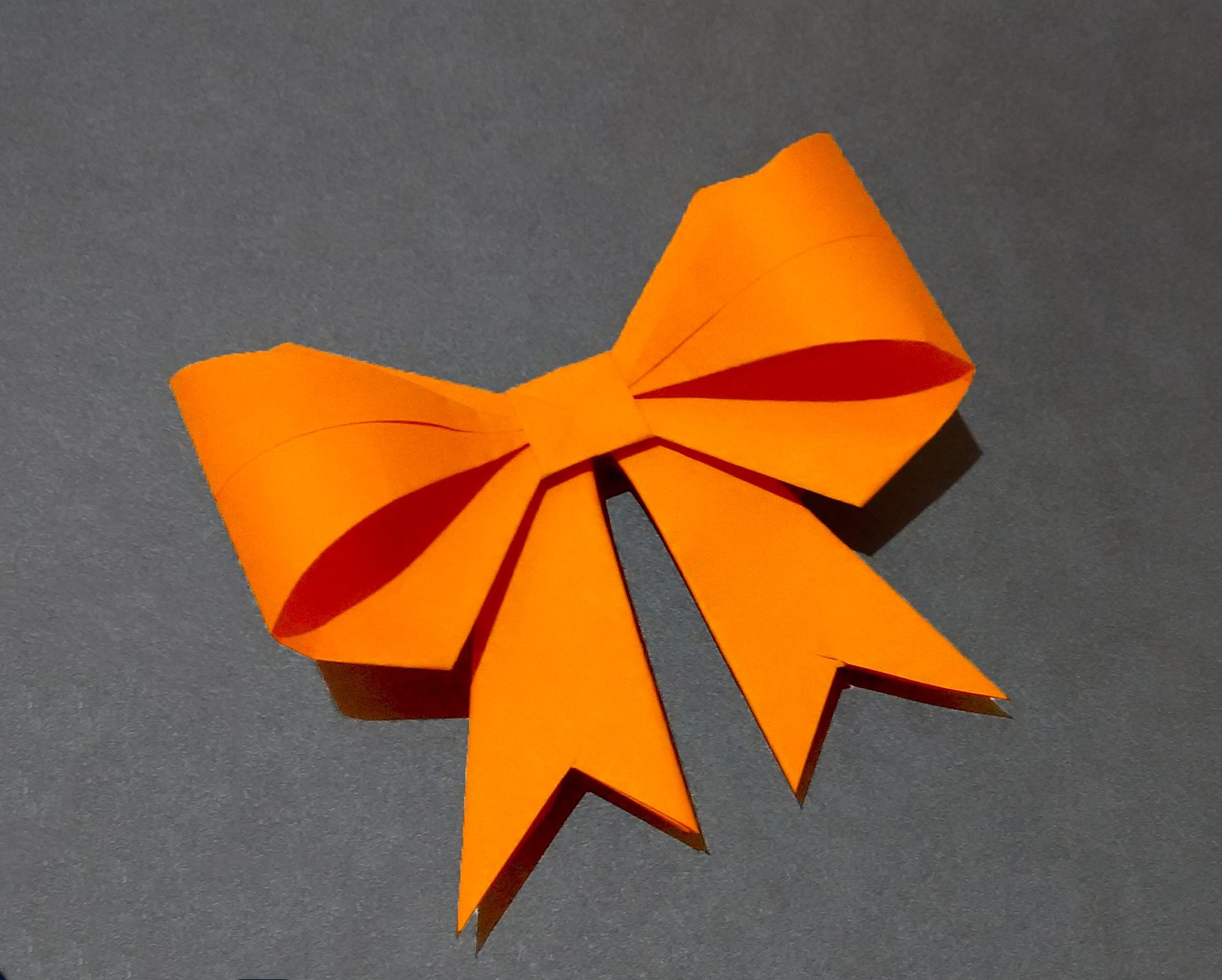 Paper bow. ribbon. Ideas for Easter decor. Origami bow for gift box decoration.